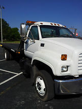 2000 GMC Rollback Tow Truck C 6500 for sale by owner located in Pensacola,FL. image 1