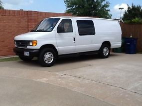 2005 FORD E350 EXTENDED VAN WITH A 6.0 DIESEL ENGINE AND SEATS 4 PEOPLE