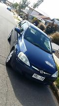 Holden Barina SXi (2004) 3D Hatchback 5 SP Manual (1.4L - Multi Point F/INJ)...